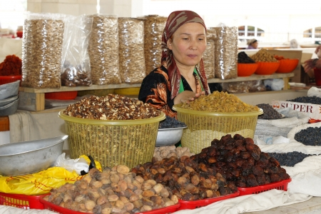 Samarkand, Uzbekistan, may 2012: Woman trading on a food market.