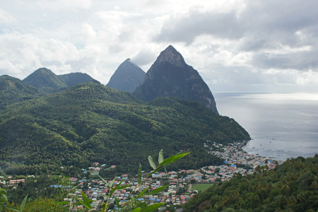 saint lucia: View over Soufriere with the famous volcano peaks of the Pitons in the background  Saint Lucia, Caribbean