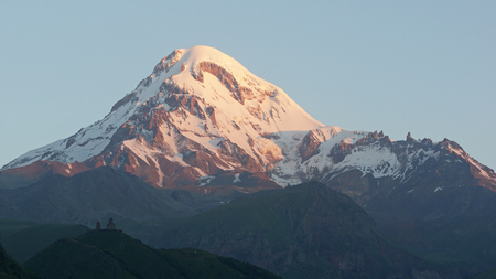 trecking: Mount Kazbek in the first light of a day, Caucasus Mountains, Georgia, Europe
