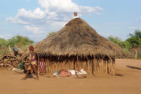 poorness: TURMI, ETHIOPIA - NOVEMBER 18, 2014: Traditional village of Hamer people on November 18, 2014 in Turmi, Ethiopia.