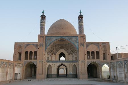 aqa: KASHAN, IRAN - OCTOBER 13, 2016: Mosque Aqa Bozorg at sundown on October 13, 2016 in Kashan, Iran, Asia