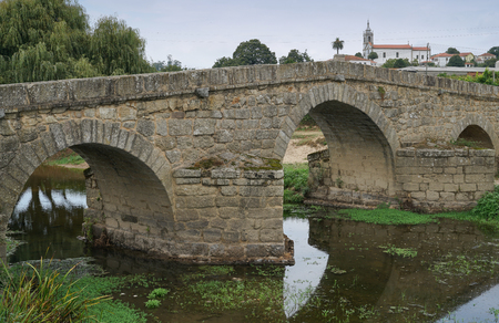 Roman bridge of Arcos, sights along the Camino de Santiago trail, Portugal