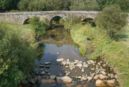 Romeinse brug dicht bij Tui, Camino de Santiago, Spanje Stockfoto