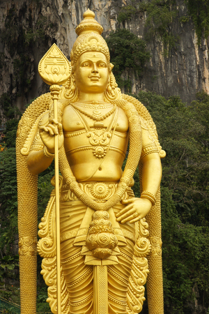 BATU CAVES, MALAYSIA - JANUARY 29, 2011: Statue of Goddess on the stairs to the holy caves of Batu on January 29, 2011 in Malaysia Editorial