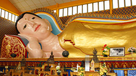 PENANG, MALAYSIA - JANUARY 28, 2011: Statue of reclining Buddha within the Thai Buddhist temple of Penang on January 28, 2011 in Malaysia, Asia