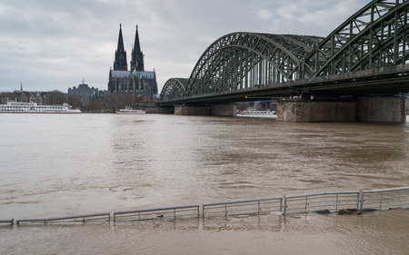 COLOGNE, GERMANY - JANUARY 7, 2018: High water on the river Rhine in Cologne on January 7, 2018 in Germany