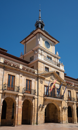 Townhall of Oviedo in early morning light with blue sky, Spain