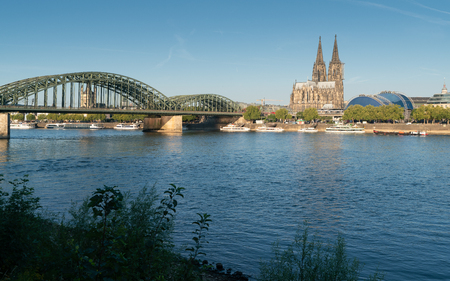 COLOGNE, GERMANY - JULY 27, 2018: Panorama of the city of Cologne with cathedral, Rhine river and Hohenzollern bridge on July 27, 2018 in Germany, Europe
