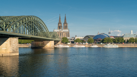 COLOGNE, GERMANY - JULY 18, 2018: Panorama of the city of Cologne with cathedral, Rhine river and Hohenzollern bridge on July 18, 2018 in Germany, Europe