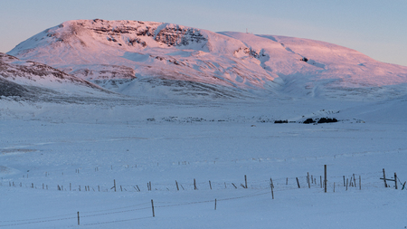 Sunrise over snow-covered mountains, Iceland, Europe Stock Photo