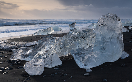 Icebergs at the black sand Diamond Beach with the sea in the background, Joekulsarlon, Iceland