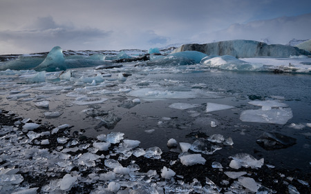 Panoramic view of the glacier lagoon Joekulsarlon with icebergs and in the background the glacier, winter in Iceland, Europe
