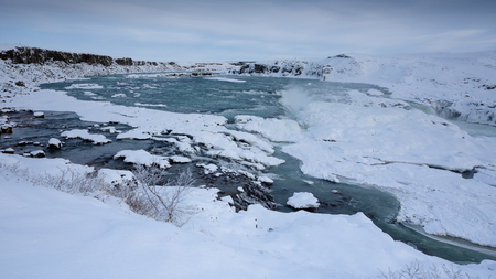 Panoramic image of the frozen waterfall Urridafoss, Iceland, Europe