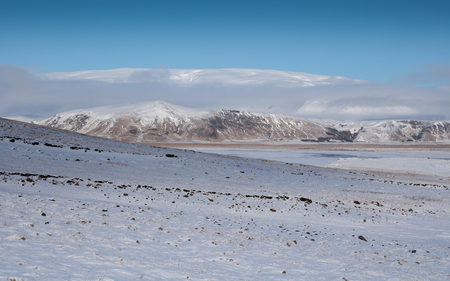 Panoramic image of the Myrdalsjo?kull glacier with low clouds, winter in Iceland