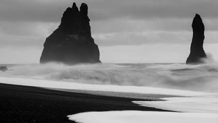 Rock spire of Reynisdrangur, coast of Reynisfjara close to Vik, Iceland, Europe