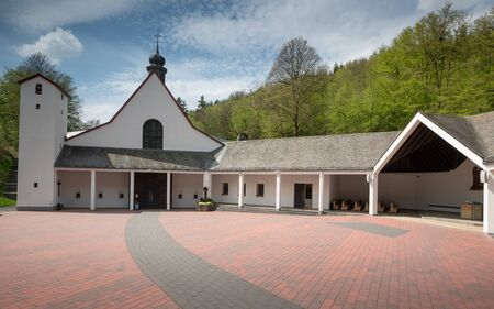 Panoramic image of the pilgrimage church of monastery Maria Martental close to Cochem on a sunny day, Germany
