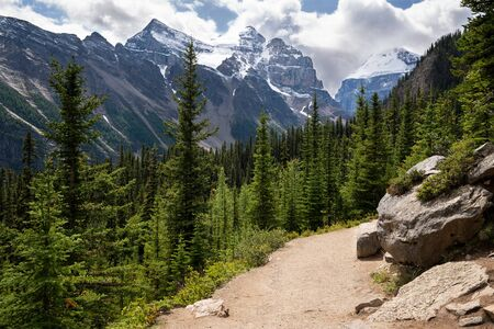 Hiking trail within the Rocky Mountains close to Lake Louise, Banff National Park, Alberta, Canada Stock Photo