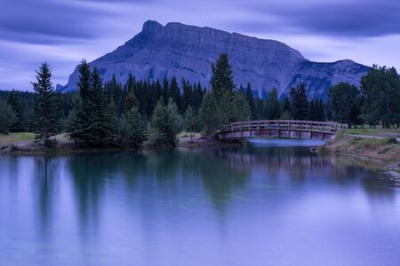 Panoramic image of early morning mood on Cascade Ponds with Mount Rundle in the background, Banff National Park, Alberta, Canada