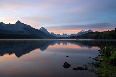 Long exposure panoramic image of the Maligne Lake close to Jasper with early morning mood, Alberta, Canada