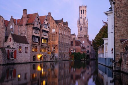 Early morning mood an the channels of Bruges with old buildings reflecting in the water, Belgium Imagens