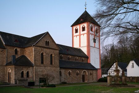 Center of village Odenthal with parish church and old buildings in early morning light, Bergisches Land, Germany Stock Photo
