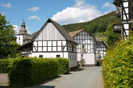 Image of an old half-timbered house against sky in summertime, Oberkirchen, Schmallenberg, Sauerland, Germany