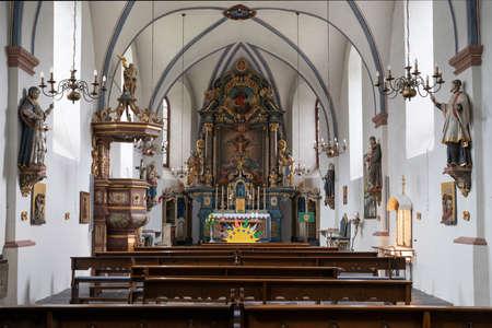SCHMALLENBERG, GERMANY - JUNE 11, 2020: View throught the main aisle of the parish church Saint Gertrudis on June 11, 2020 in Schmallenberg, Germany