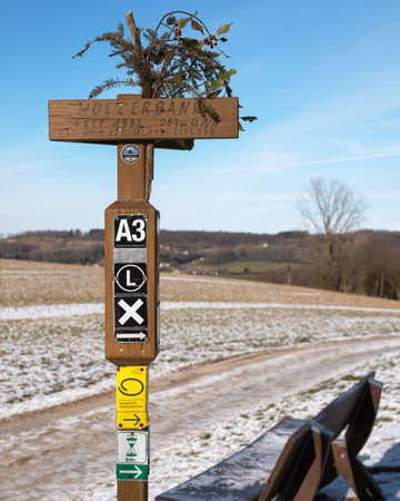 KURTEN, GERMANY - MARCH 6, 2021: Long distance hiking trail Bergischer Panoramasteig with focus on the typical waymark on March 6, 2021 in Germany