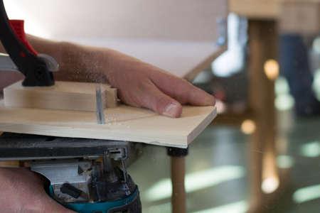 carpenter vise: Carpenter working with Jigsaw