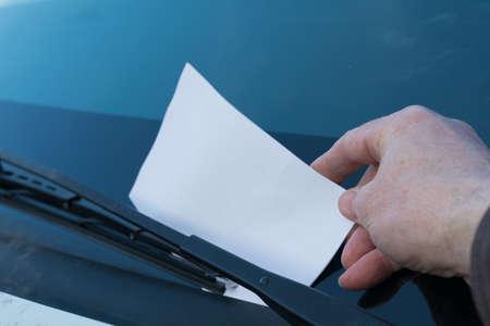 dagvaarding: Speeding ticket is stapled by parking attendant windshield