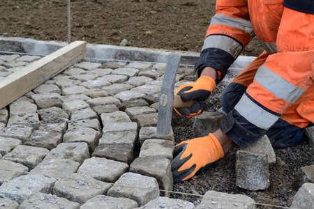 pavers: Street worker puts pavers