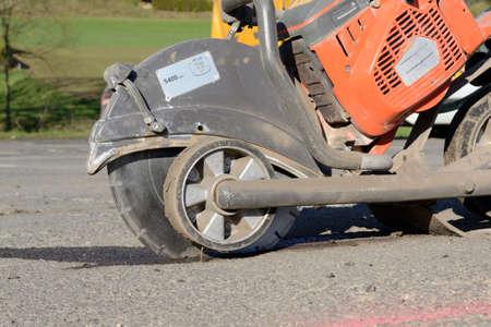 bulkhead: On Construction Site Asphalt cutter is used Stock Photo