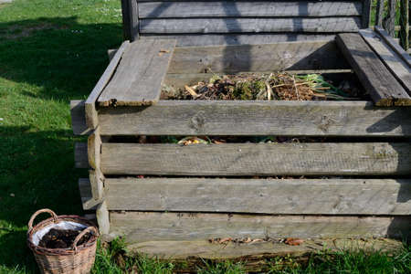 garden waste: Old Garden composter made of wood waste Stock Photo