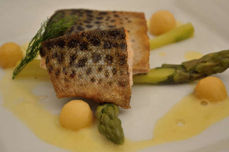deliciously: Deliciously prepared fried trout with asparagus and sauce Stock Photo