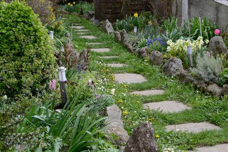 flagstone: Flagstone form way by a flowery garden