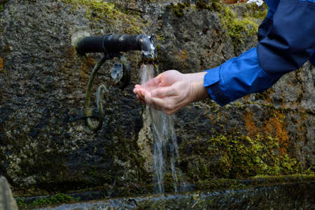 mains: Person refreshed at a drinking water source