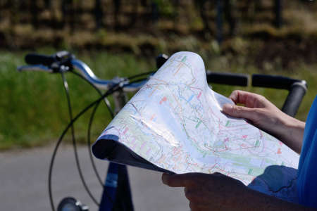 seeks: Person seeks guidance on a cycling map