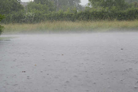 downpour: Strong downpours burst in a storm on the road Stock Photo