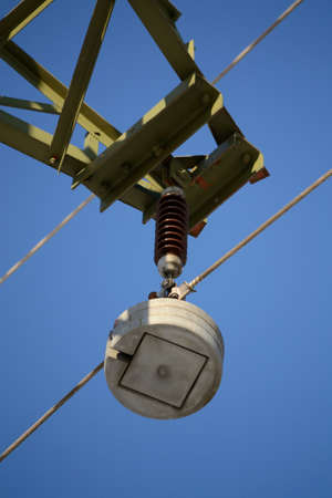 outage: Insulator a high-voltage line - closeup