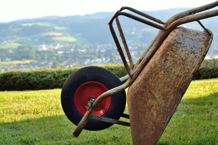 rustiness: Old rusty wheelbarrow in the great outdoors