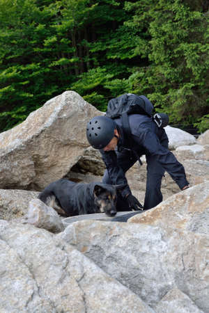 sleuth: Man with his rescue dog in the search service after missing person