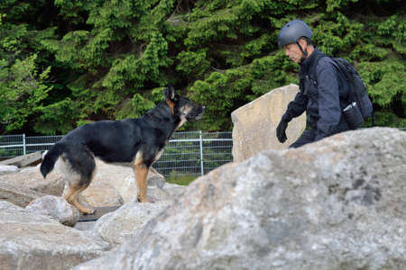 drudgery: Man looking with his rescue dog after missing person Stock Photo