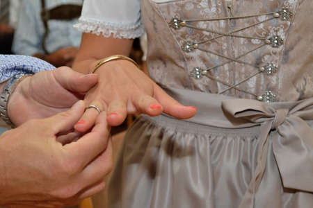 affiance: Groom gives the bride in dress wedding ring