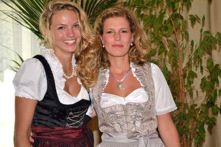 womankind: Two girlfriends in dirndl dress Stock Photo