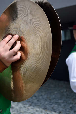 cymbals: Musician with the instrument cymbals - close-up
