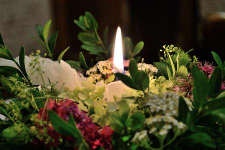 romantic candle light on a floral arrangement