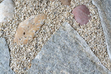 artisanry: On the ground laid stone slabs and gravel - Closeup of pattern