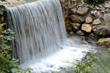 runnel: small stream with wide waterfall Stock Photo