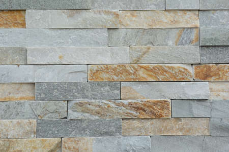 patterning: smooth natural stones forming a stone wall Stock Photo