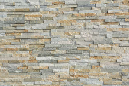 patterning: thin natural stones form a pattern in a stone wall Stock Photo